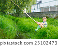 Little kid boy fishing on river with selfmade 23102473