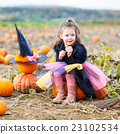 little girl wearing halloween witch costume on 23102534