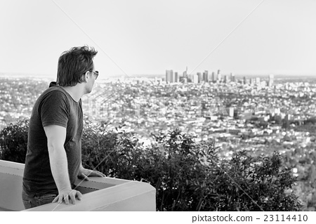 Man looking on downtown Los Angeles, California 23114410
