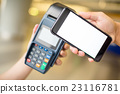 Woman pay by cellphone with NFC technology 23116781