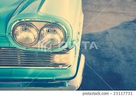Headlight of a vintage car . ( Filtered image processed vintage effect. ) 23117731