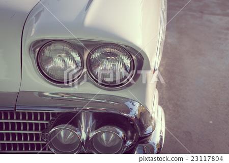Headlight of a vintage car . ( Filtered image processed vintage effect. ) 23117804