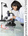 Woman appraiser gems in laboratory 23127666