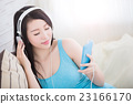 woman enjoying the music 23166170