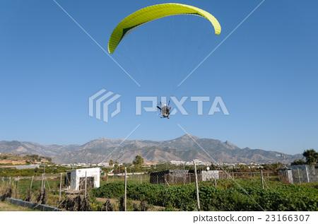 Yellow motor- driven paraglider 23166307