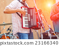 Close up musicians are playing accordion on stage 23166340