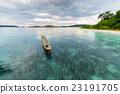 Traditional canoe floating at sunset, blurred motion, Indonesia 23191705