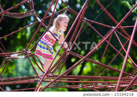 Child having fun on school yard playground 23194218