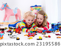 Little kids playing with toy cars 23195586