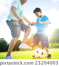Little Boy Playing Soccer With His Father Concept 23204003