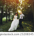 bride and groom dancing in nature 23208345