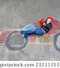 Little boy having fun with race car drawing with 23211353
