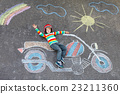 Little kid boy in helmet with motorcycle chalks 23211360