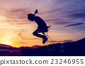 Girl  jumping rope in silhouette with sun set 23246955