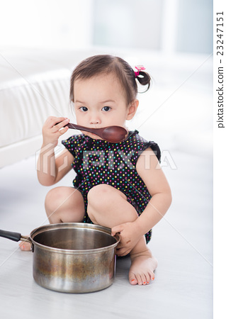 Asian child playing a chef at home. 23247151
