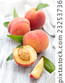 Peaches on rustic table. 23253736