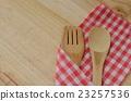 Wooden kitchen utensils on wooden background 23257536