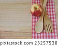Wooden kitchen utensils on wooden background 23257538