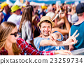 Teenagers at summer music festival enjoying 23259734