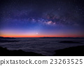 milky way on night sky over foggy mountain 23263525