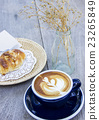 Breakfast coffee and almond croissant  23265849