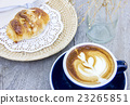 Breakfast coffee and almond croissant  23265851