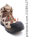 Miniature technician repairing  boot shoe 23280127