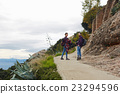 Couple hiking on a mountain trail together 23294596