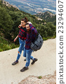 Hipster man and woman are walking outdoors 23294607