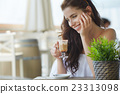 Portrait of beautiful blond woman sitting in outdoors cafe in It 23313098