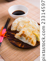 Gyoza dumplings on mini wooden dish 23314597
