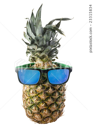 Pineapple Sunglasses  isolated pineapple with sunglasses for summer stock photo