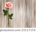 Single pink rose on an old wooden background. 23317155