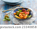 Salad with grilled prawns. 23340858