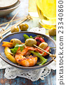 Salad with grilled prawns. 23340860