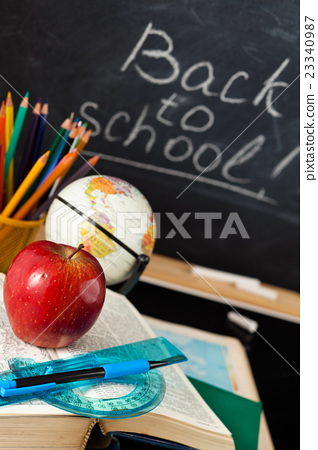 School supplies against blackboard. 23340987