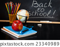 School supplies against blackboard. 23340989