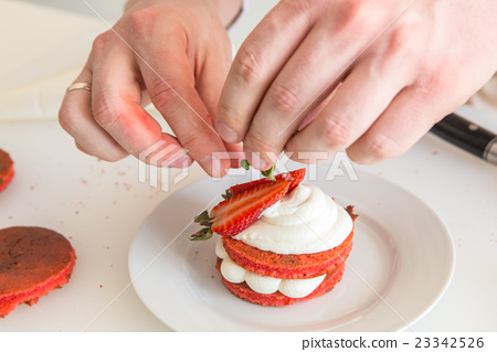Hands of the cook fill a kannellona tubule with a  23342526