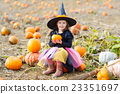 little girl wearing halloween witch costume on 23351697