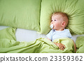 One year old baby in the bed 23359362