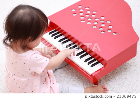 Baby (Toy piano toy baby 1 year old 1 year old smile laugh play toy child child baby) 23369475