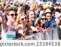 Teenagers at summer music festival having good 23394538