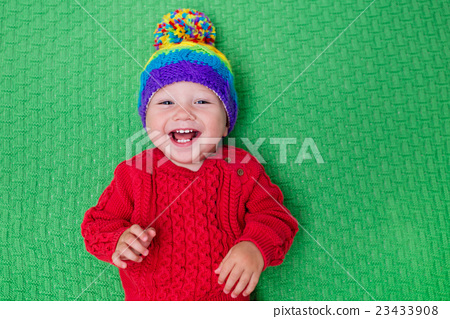 Stock Photo: Little baby in warm knitted hat