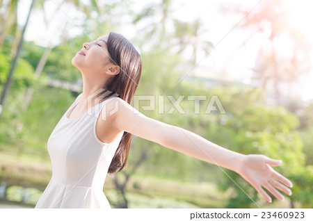 young woman raising her arms 23460923