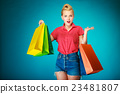 Pinup girl with shopping bags buying clothes. Sale 23481807