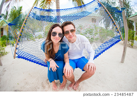 Stock Photo: Happy Couple On The Beach In Honeymoon