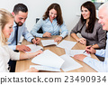 Lawyers having team meeting in law firm 23490934