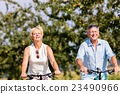 Senior woman and man at bicycle tour 23490966