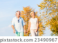 Senior couple, woman and man, having walk 23490967