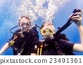 Man and woman scuba divers in tropical sea  23491361
